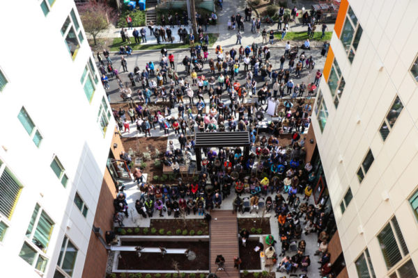 Aerial view: Community members gather to celebrate at the Liberty Bank Building Ribbon Cutting Celebration